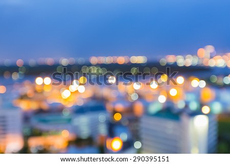 Abstract blur bokeh city lights during twilight - stock photo