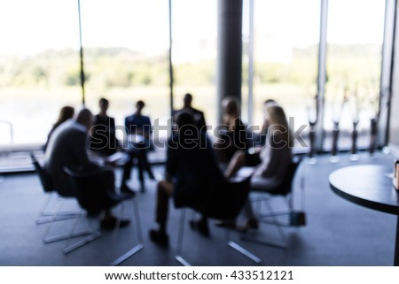 Abstract blur Business meeting, business, press, news and people and concept - close up of young smiling businessman reading newspaper over office building - stock photo
