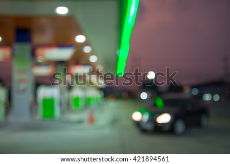 Abstract blur car in petrol gas station evening twilight background - stock photo