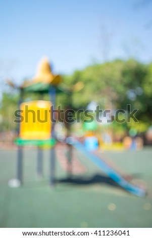 Abstract blur children playground in city park background with sunlight - stock photo