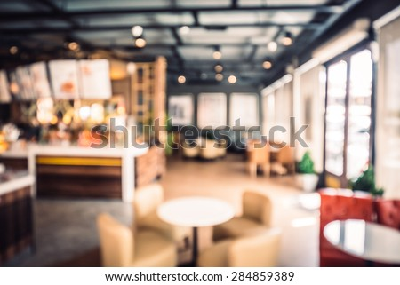 Abstract blur coffee shop background - vintage filter effect - stock photo