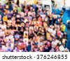 abstract blur crowd of people watching concert or sport event. - stock photo