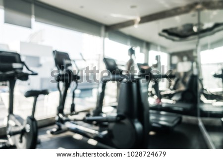 Abstract blur defocused fitness equipment and gym interior for background