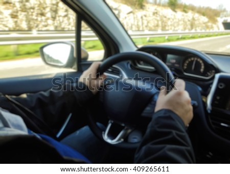 Abstract blur driving on road, view of driver in car