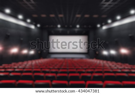 Abstract blur Empty rows of red theater or movie seats. Chairs in cinema hall. Comfortable armchair - stock photo