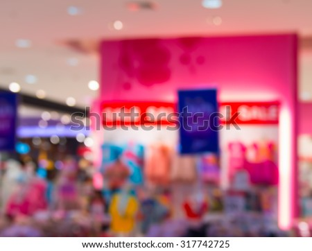 Abstract blur fashionable women's clothing store in the mall. - stock photo