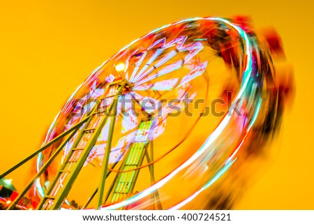 Abstract Blur Ferris wheel in park - stock photo