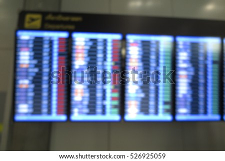 Abstract blur Flight timetable screen in airport terminal
