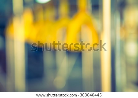Abstract blur  Handles passenger inside a bus.  ( Filtered image processed vintage effect. ) - stock photo