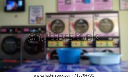 abstract blur image of Row of washing machines in closeup