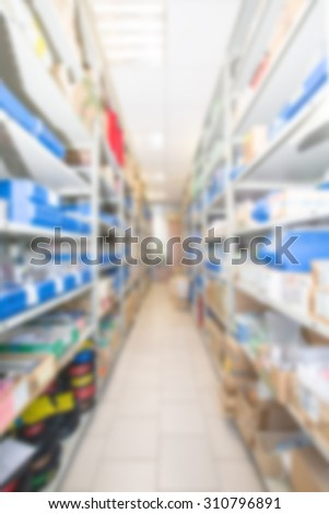 Abstract blur image, shelving in the warehouse of finished products and materials. - stock photo