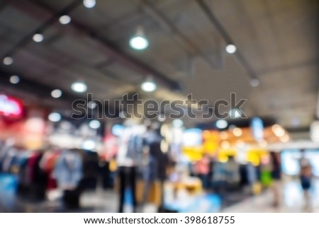Abstract blur jeans shop in the mall shopping department store. - stock photo