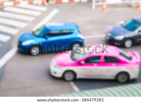 abstract blur many car at the pedestrian zebra traffic walk way in the city. - stock photo