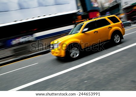 Abstract blur of a speeding taxi SUV truck in New York City.  Slow shutter speed panning technique used for intentional motion blur. - stock photo