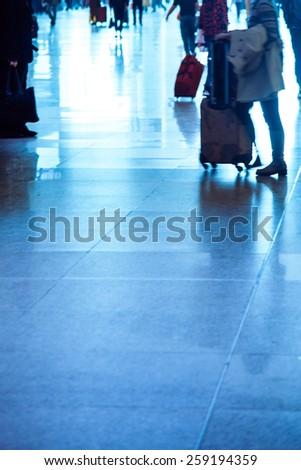 abstract blur of passenger rushing at big city station. - stock photo