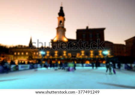 Abstract blur of people skating in the park in evening on winter skating rink, Salzburg, Austria