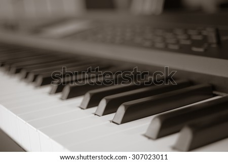 abstract blur of Piano Keyboard synthesizer closeup key frontal view, vintage theme - stock photo