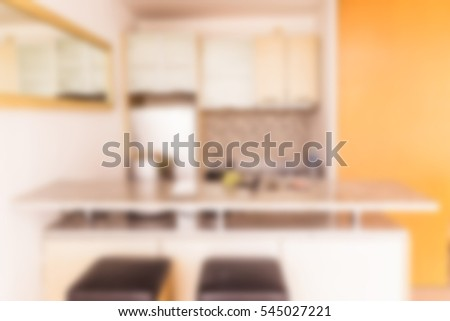 Abstract blur of small kitchen with counter bar, modern style villa