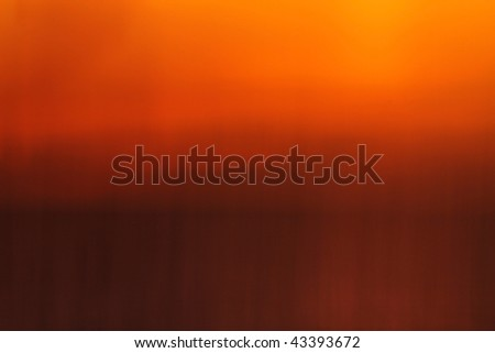 Abstract blur of sun setting over Long Beach Harbor in southern California, USA. - stock photo