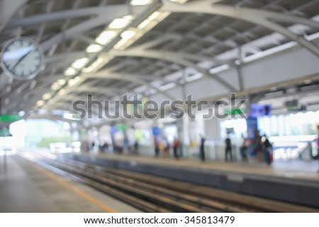 abstract blur of train station backgrounds:blurred of railway sky train transportation concept:blur people waiting.blurry inside construction train station conceptual.