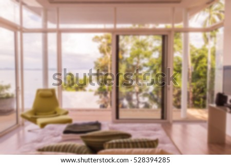 Abstract blur of view from bedroom to pool and sea can be used for background