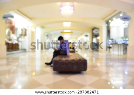 Abstract Blur or Defocus Background of People or Business man using Mobile Phone in Hotel Lobby - stock photo