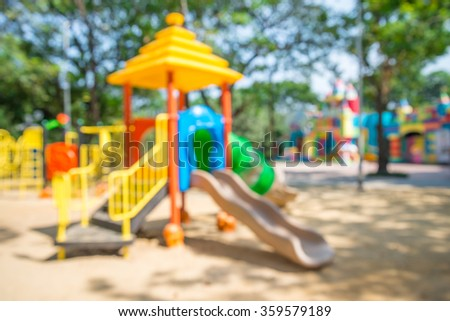 Abstract blur outdoor children playground in Bangkok city park background