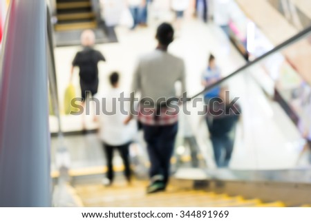 abstract blur people  moving escalator motion in a shopping mall - stock photo