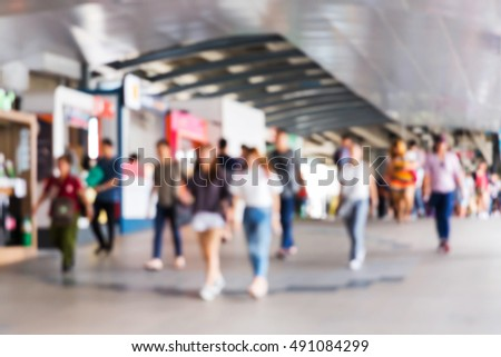 Abstract blur people on electric sky train station, railroad transportation for passenger in city, 