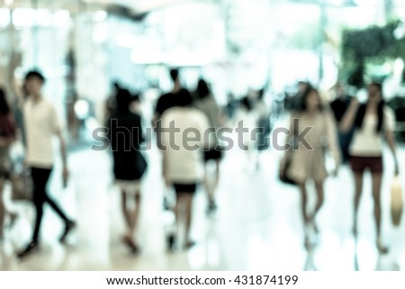 Abstract blur people walking in fashion mall. Cold color filter. - stock photo