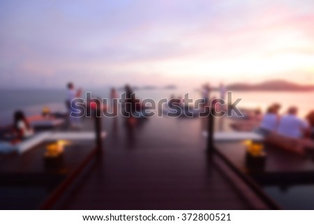 Abstract blur People watching sunset - stock photo
