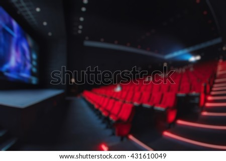 Abstract blur red theater or movie seats. Chairs in cinema hall. Comfortable armchair - stock photo