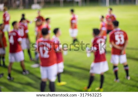 Abstract blur soccer players halftime rest - stock photo
