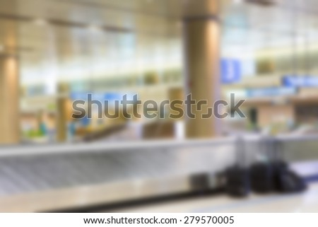 Abstract blur Suitcases and  luggage band on the airport - stock photo