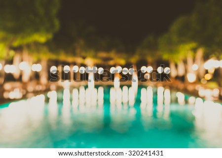 Abstract blur swimming pool in hotel resort background - vintage filter effect