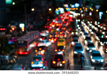 Abstract blur traffic jam at night in Bangkok.background
