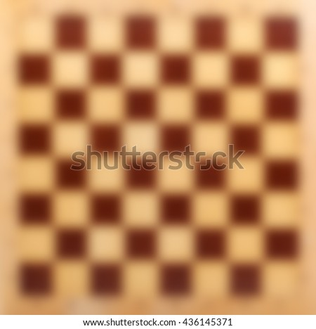 Abstract blur wooden chessboard bokeh background - stock photo
