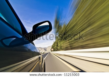 Abstract blurred action from car at high speed - stock photo