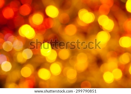 abstract blurred background - brown, yellow and red twinkling Christmas lights of electric garlands on Xmas tree - stock photo