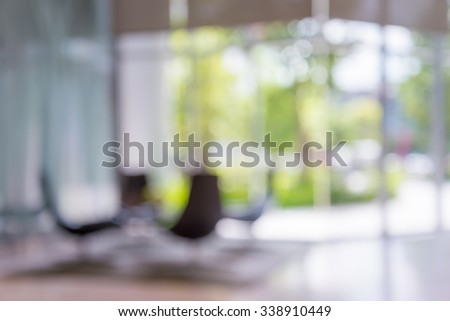 Abstract blurred background chairs in hotel luxury lobby - stock photo