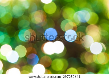 abstract blurred background - green shimmering Christmas lights bokeh of electric garlands on Xmas tree - stock photo