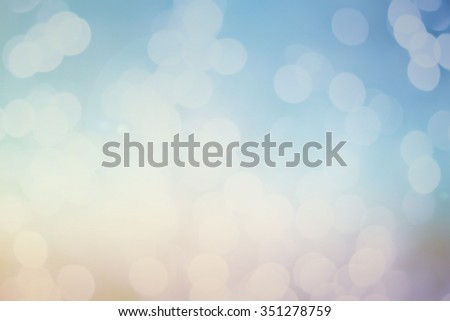 abstract blurred background of evening sky backdrop with circle lights in pastel tone color.blur of warm tone bokeh bulbs:Christmas festive backdrop concept.blurry bubble glitter sparkle round. - stock photo