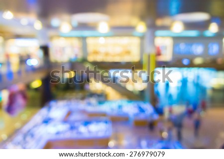 Abstract blurred background of illumination inside of shopping mall - stock photo