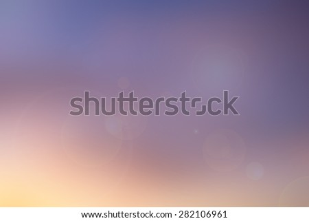 abstract blurred background of night sky hour with aura sunshine lens flare lights.blur landscape sunset hours.blurry evening wallpaper.ideal natural pastel colorful backdrop concept.warm tone color - stock photo