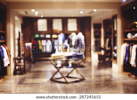 abstract blurred background of people in shop, sale concept - stock photo