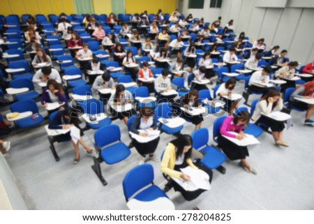 Abstract blurred background of students in a large lecture room