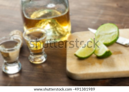 Abstract Blurred Background Of Tequila Shot Drinks With Limes for Drinking. Blur Applied. Copy Space.
