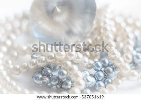 Abstract blurred background, pearl necklace on white. Macro shot, Shallow depth of field, defocused