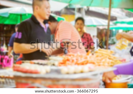 Abstract blurred background : People shopping at the foods market in the old town.