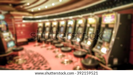 Abstract blurred background : Slot machines in Casino gaming room. Casino, gambling addiction concept.